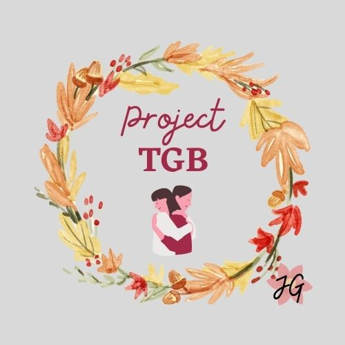 A wreath with ProjectTGB written inside it. Two women hug each other as a way of expressing thanks to each other for ProjectTGB - A small project to Express Gratitude for the people in our lives!